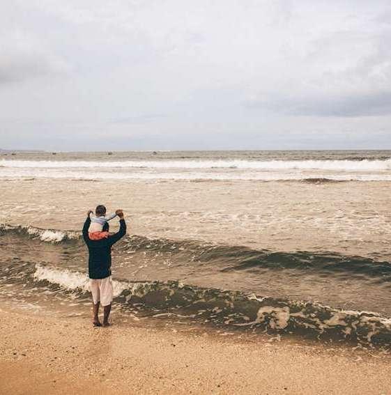 kuta beach bali resorts hard rock hotel man in water with child