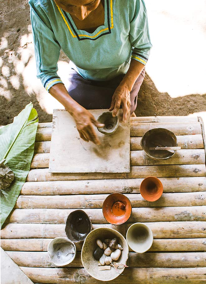 a woman making pottery, native amazonian, tena, ecuador.