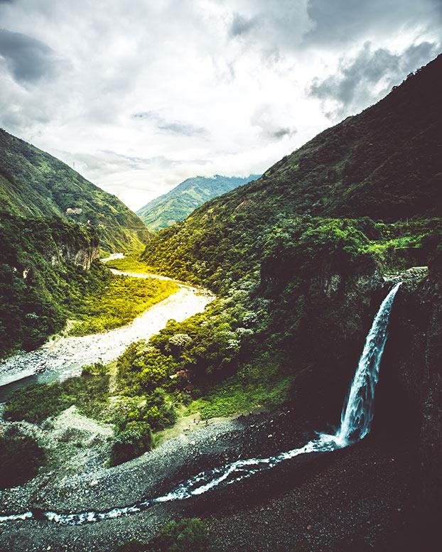 A view of a waterfall, mountains and sky in banos, ecuador, taken on  taken on ecuador vacation
