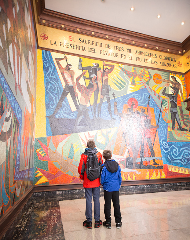two children viewing a mural in presidentail palace quito, ecuador