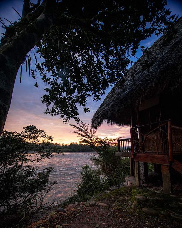 sunrise sky and house in cotococha lodge, tena, ecuador