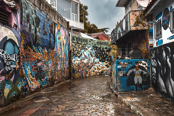 The Murals of Beco De Batman - a street densely covered with murals, including a picture of batman, things to do in Brazil.