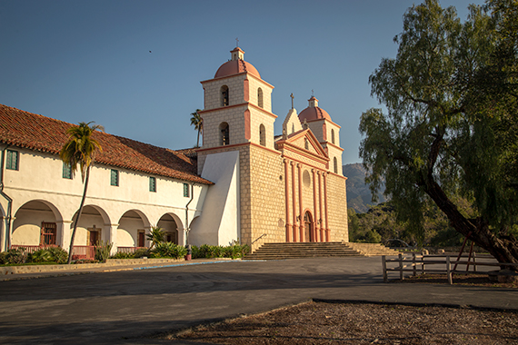 The mission of santa barabara, featuring two towers and Spanish architecture as seen on a bright summer day, on the pacific coast highway.