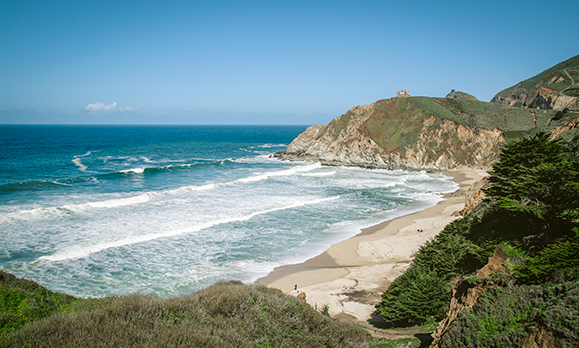 pacific coast highway stop, grey whale cove.  Beach, mountains, ocean and sky.