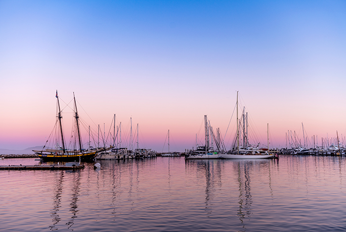 boats docked in water, sunset in the background, views from stearns wharf, pacific coast highway, santa barbara