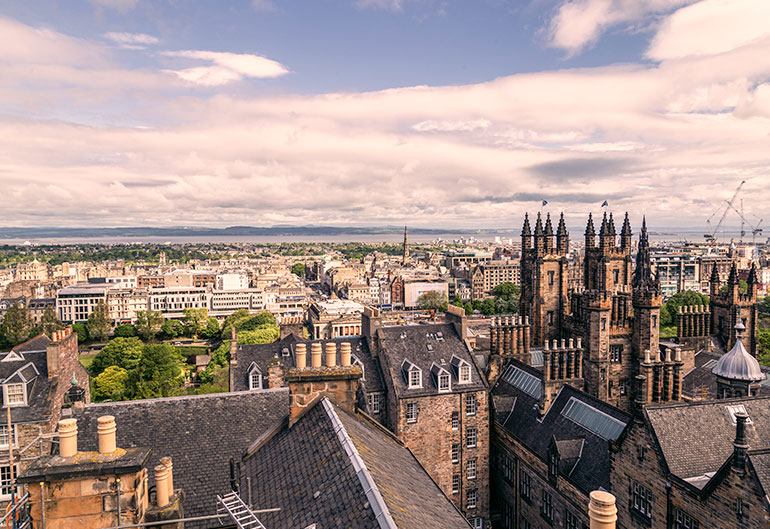 Edinburgh city skyline including old buildings and towers, picture taken in the daytime.
