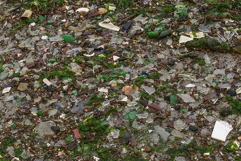 A large mass of broken glass in small pieces and in various colors, as seen in Dead Horse Bay, 2019.