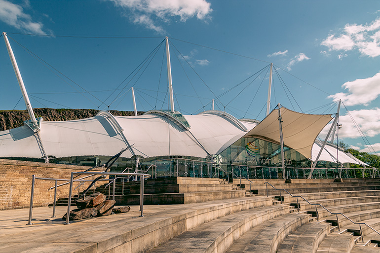 Dynamic earth center in Edinburgh - unique things to do in Edinburgh. A modern building exterior photographed during daytime.