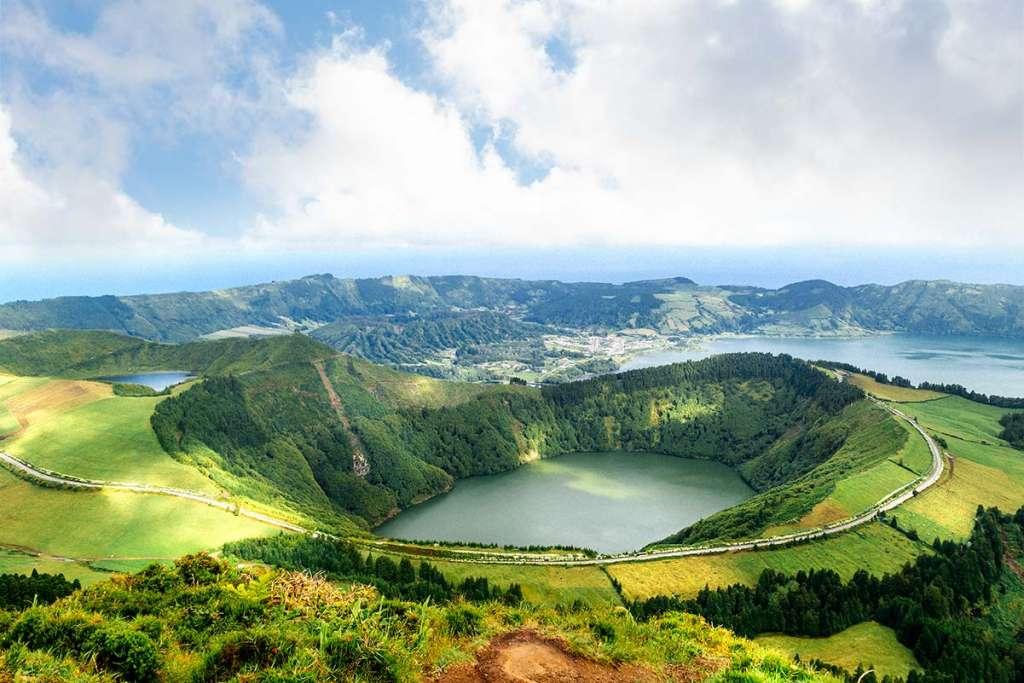 A lake in a volcanic caldera as seen from Miradouro da boca do inferno.