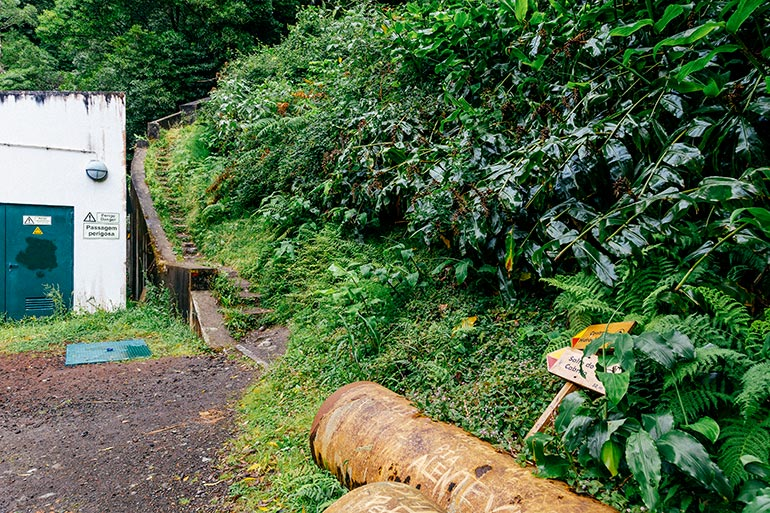 """A large pipe, stairway and sign to """"Salto Do Cabrito."""""""