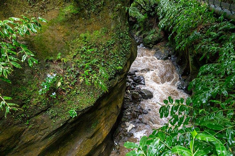 Rushing water beneath a cliff in Salto Do Cabrito.