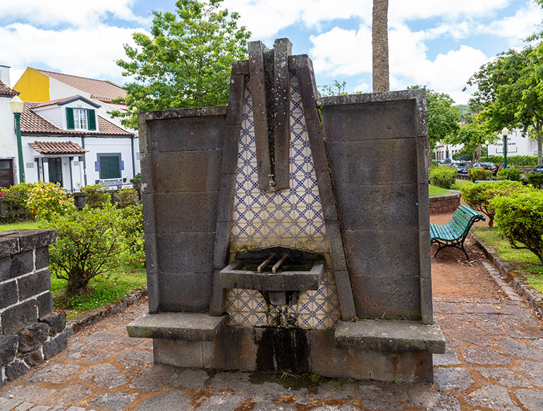 An old drinking fountain with complex decorations.   Caldeiras Vulcanicas, Caldera in Furnas, Sao Miguel, Azores