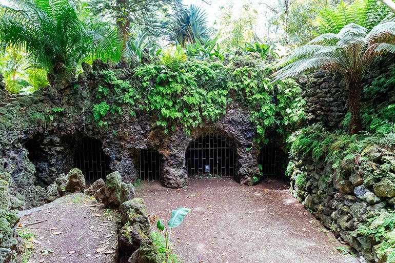 Caves carved into volcanic rock and covered with guard rails in Jardim Antonio Borges