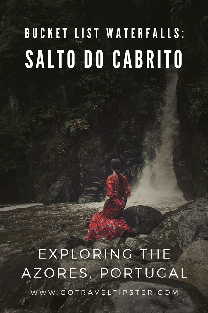A dark haired woman in a red dress facing the waterfalls of Salto Do Cabrito.