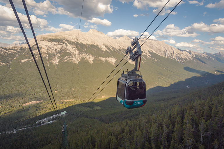 The Banff gondola ride, a shuttle moving down the mountain.