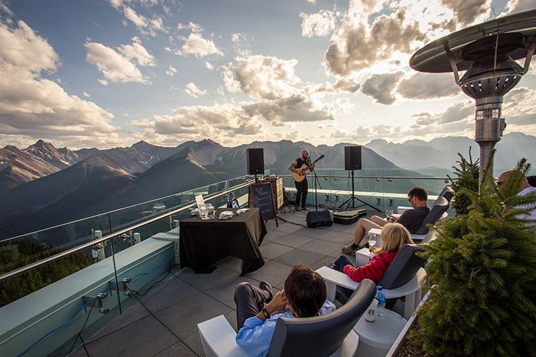 A singer performs at Sunset Festival on Banff Gondola.