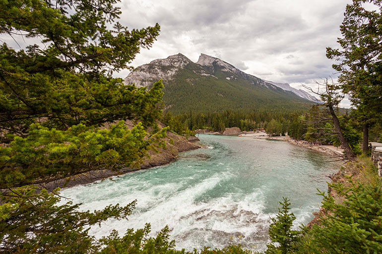 The river, mountains and trees in Banff National Park.