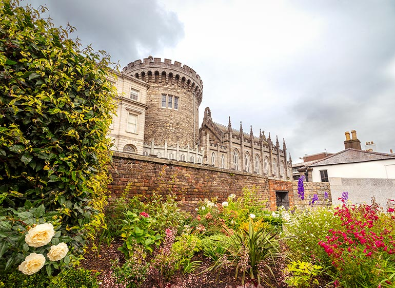 Dublin Castle in the background, flowers in the foreground - things to do in Dublin.