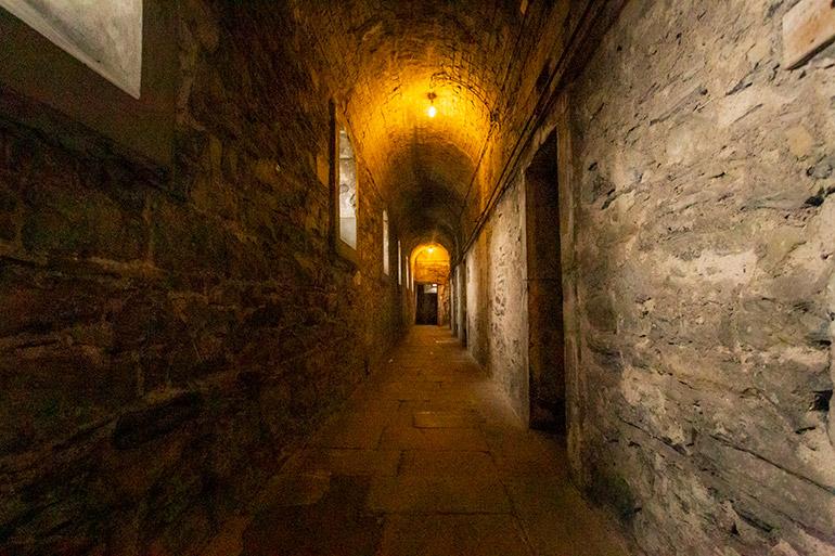 A dimply lit corridor in Kilmainham Gaol, things to do in Dublin.