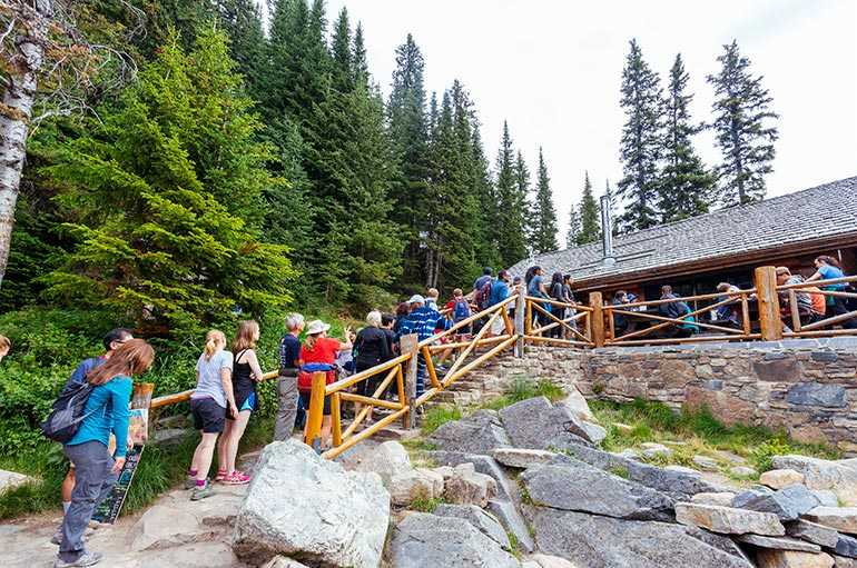 Dozens of people waiting in line to Lake Agnes Tea House, Banff National Park