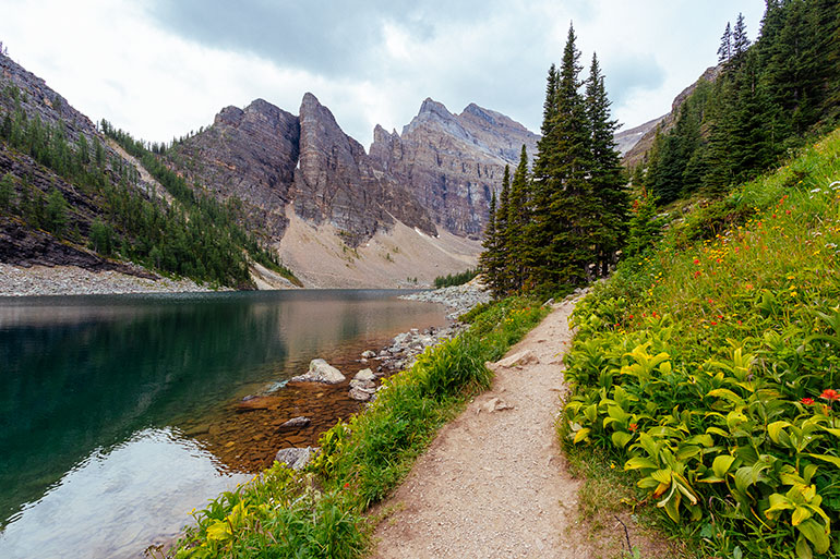 A trail runs along lake Agnes, Banff National Park, Canada.