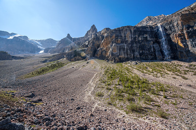 A gravel path in the mountains leads to the Stanley Glacier.