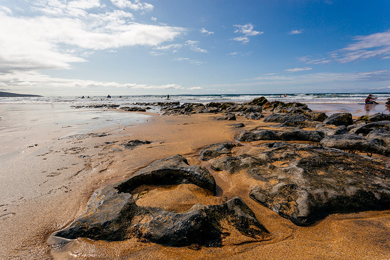 The boulders immersed in sand on Fanore Beach.