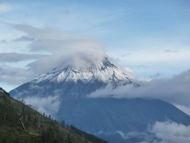 The Tungurahua volcano in Banos partially covered in clouds.