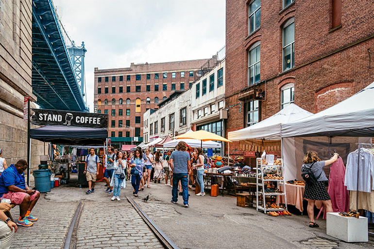 People shopping in the Brooklyn Flea Market in DUMBO.
