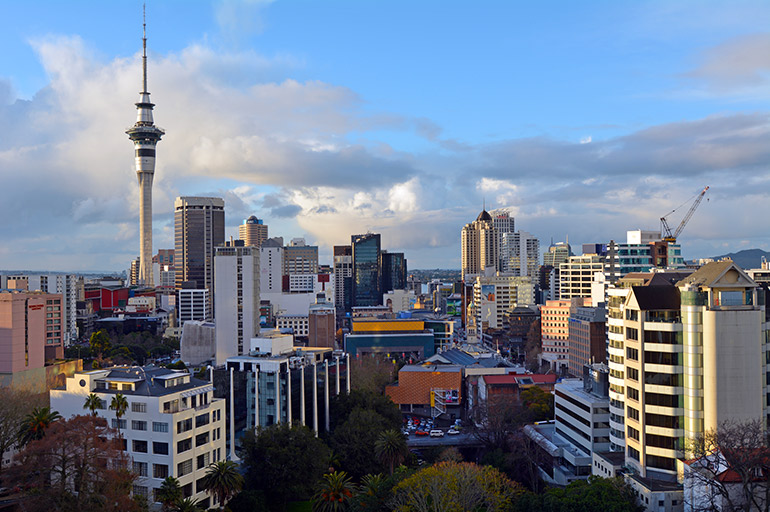 Auckland skyline with Sky Tower prominently featured.